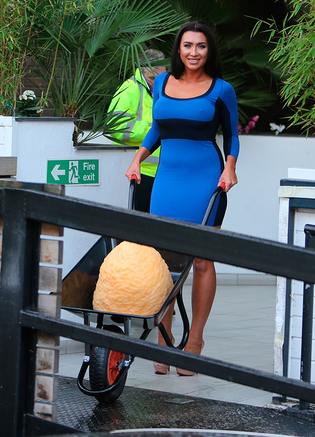 Lauren Goodger outside ITV Studios with a wheelbarrow showing how much weight she has lost
