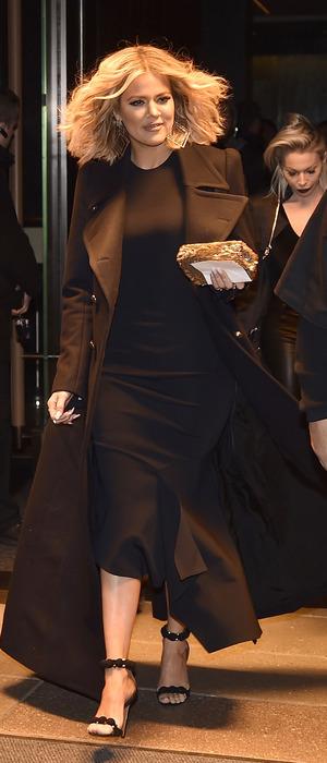 Khloe Kardashian wearing black dress, black coat and black shoes in New York City, America, 15th January 2016