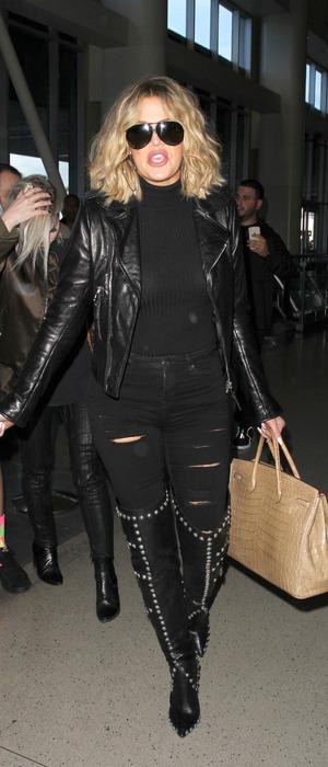 Khloe Kardashian arrives at L.A.X International airport with make-up artist Joyce Bonelli, wearing all-black 16th January 2016