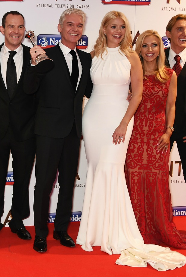 Holly Willoughby (3rdR) and Phillip Schofield (4thR) and team of 'This Morning' accept the award for Best Live Magazine at the 21st National Television Awards at The O2 Arena on January 20, 2016 in London, England.