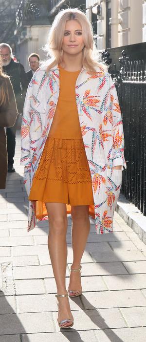 Pixie Lott looks effortlessly stylish in orange dress and palm tree printed jacket, London, 28th January 2016