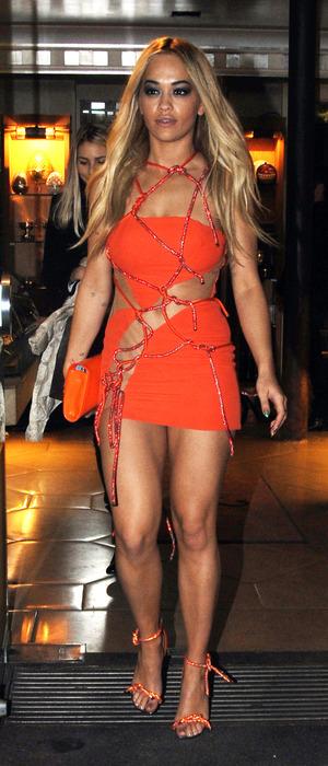 Rita Ora wears orange rope dress to Versace's Couture Paris Fashion Week show in Paris, France, 25th January 2016