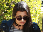 Kourtney Kardashian keeps it casual in trainers and leather in Hollywood