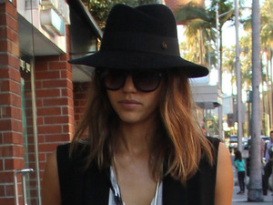 Love or loathe? Jessica Alba stands out in ankle-grazing dress & clogs!