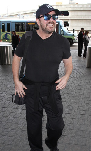 Ricky Gervais departs on a flight from Los Angeles International Airport (LAX) with girlfriend Jane Fallon, 11th January 2016