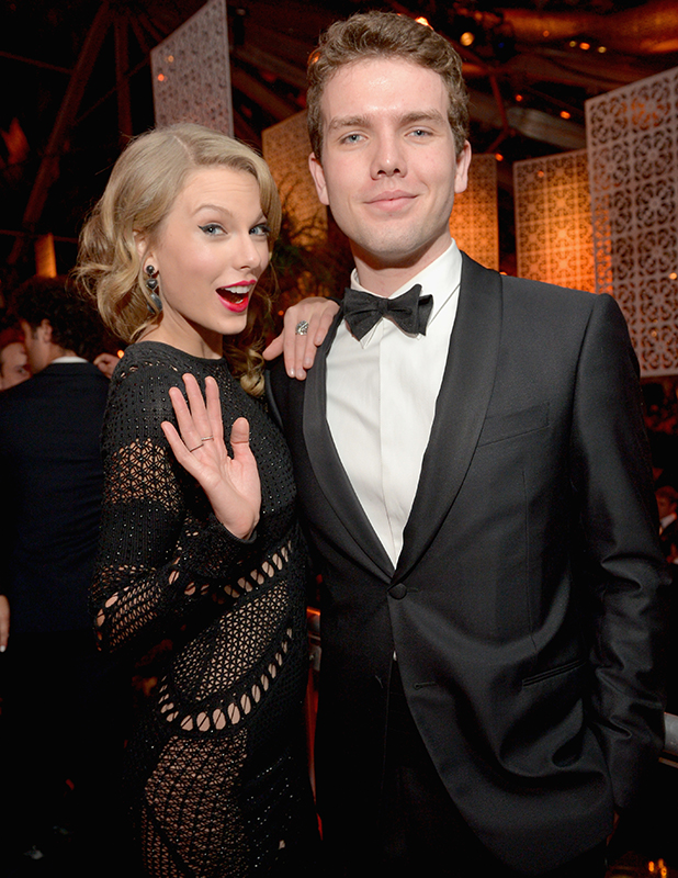 Taylor Swift (L) and Austin Swift attend The Weinstein Company & Netflix's 2014 Golden Globes After Party presented by Bombardier, FIJI Water, Lexus, Laura Mercier, Marie Claire and Yucaipa Films at The Beverly Hilton Hotel on January 12, 2014 in Beverly Hills, California. (Photo by Charley Gallay/Getty Images for The Weinstein Company)