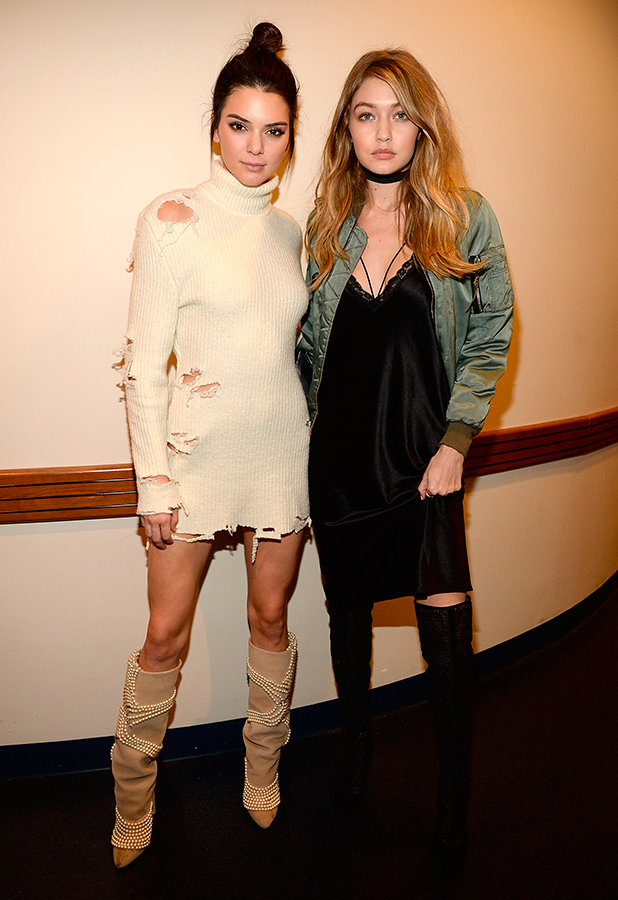 Kendall Jenner and Gigi Hadid attend Kanye West Yeezy Season 3 at Madison Square Garden on February 11, 2016 in New York City.