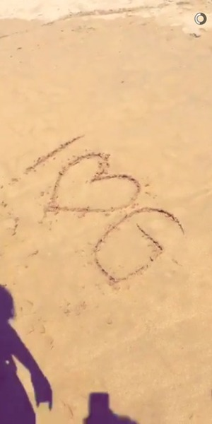 Charlotte Crosby writes Gaz Beadle's name in the sand, Australia 16 February
