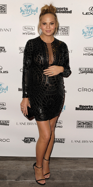 Pregnant Chrissy Teigen attends A Night at Sea VIP Boat Cruise sponsored by Sports Illustrated Swimsuit 2016 Yacht Cruise in Miami City on February 18, 2016