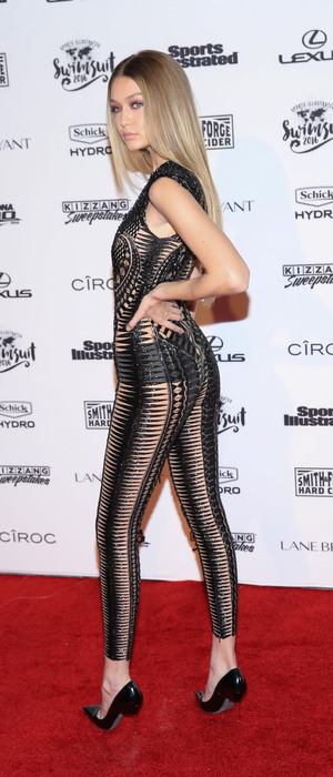 Victoria's Secret Model Gigi Hadid poses on red carpet in see-through jumpsuit at the Illustrated Swimsuit Event in New York, 17th February 2016