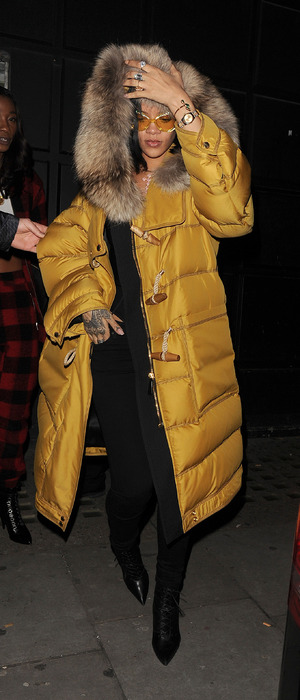 Rihanna lands in London wearing bright yellow puffa jacket with faux fur trim hood, 23rd February 2016