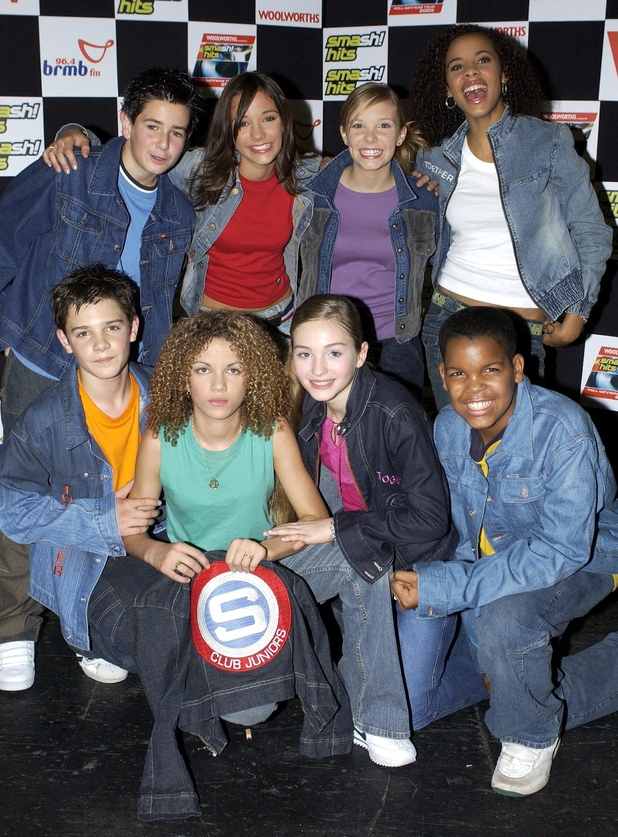 Pop group S Club Juniors pose with their award for Best Newcomer at the Disney Channel Kids Awards at the London Arena, London on October 12, 2002.