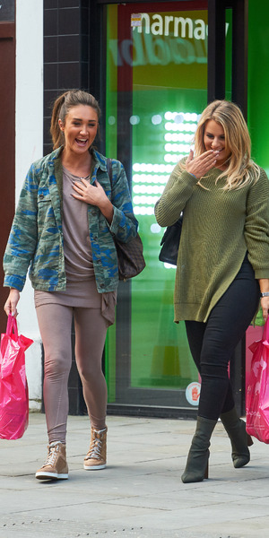 Megan McKenna and Danielle Armstrong shopping in Superdrug, Watford, February 2016