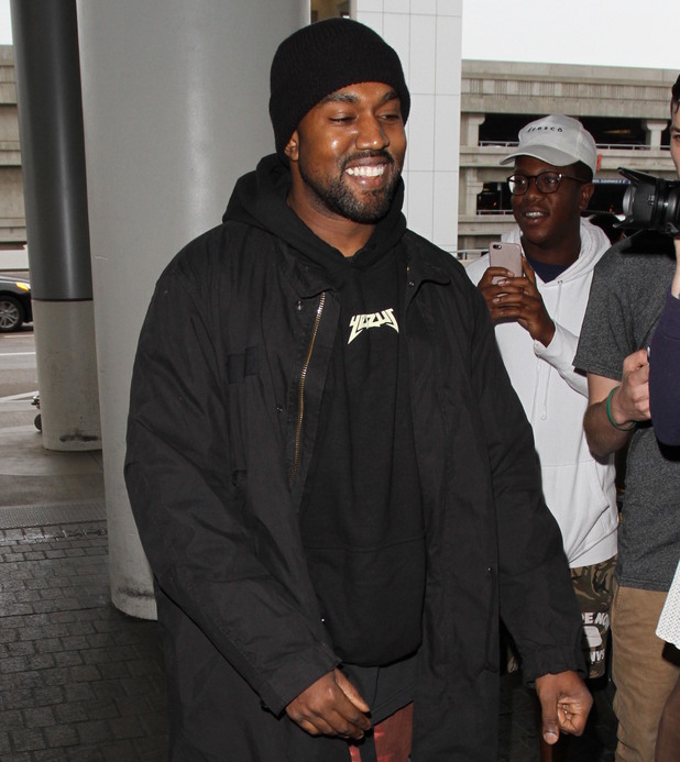Kanye West departs on a flight from Los Angeles International Airport (LAX). 17 February 2016.