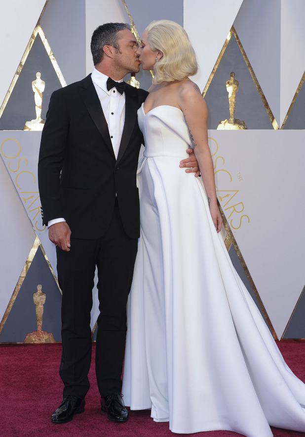 Lady Gaga and Taylor Kinney on the red carpet at the Oscars. 28 February 2016.
