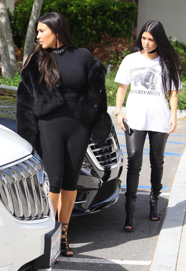 Kim Kardashian and Kourtney Kardashian spotted outside Hugo's restaurant in Los Angeles, 9th March 2016