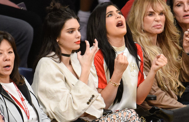Kendall Jenner and younger sister Kylie Jenner attend the L.A Lakers game in Los Angeles, 15th March 2016