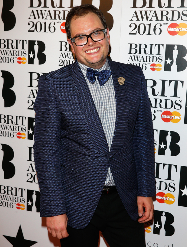 Alan Carr poses in the winners room at the BRIT Awards 2016 at The O2 Arena on February 24, 2016 in London, England.