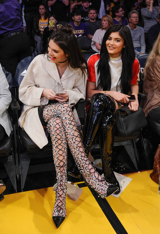 Kendall Jenner and sister Kylie Jenner attend the L.A Lakers game in Los Angeles, 15th March 2016