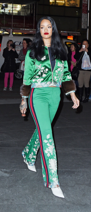 Singer-songwriter Rihanna wears bright green two-piece while out and about in New York, 28th March 2016