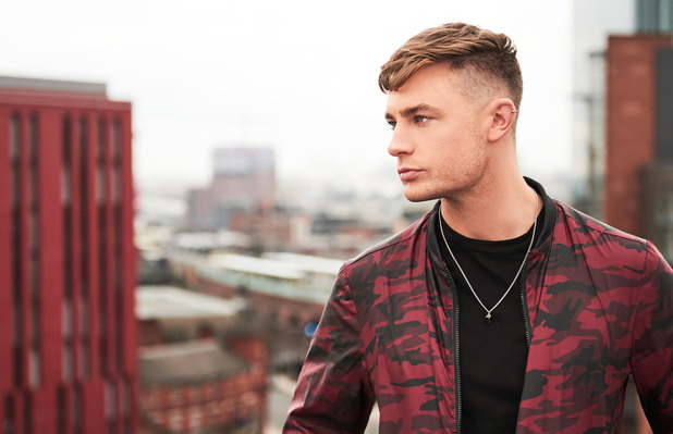Geordie Shore's Scotty T is announced as the new face of BoohooMAN, wearing bomber jacket 31st March 2016