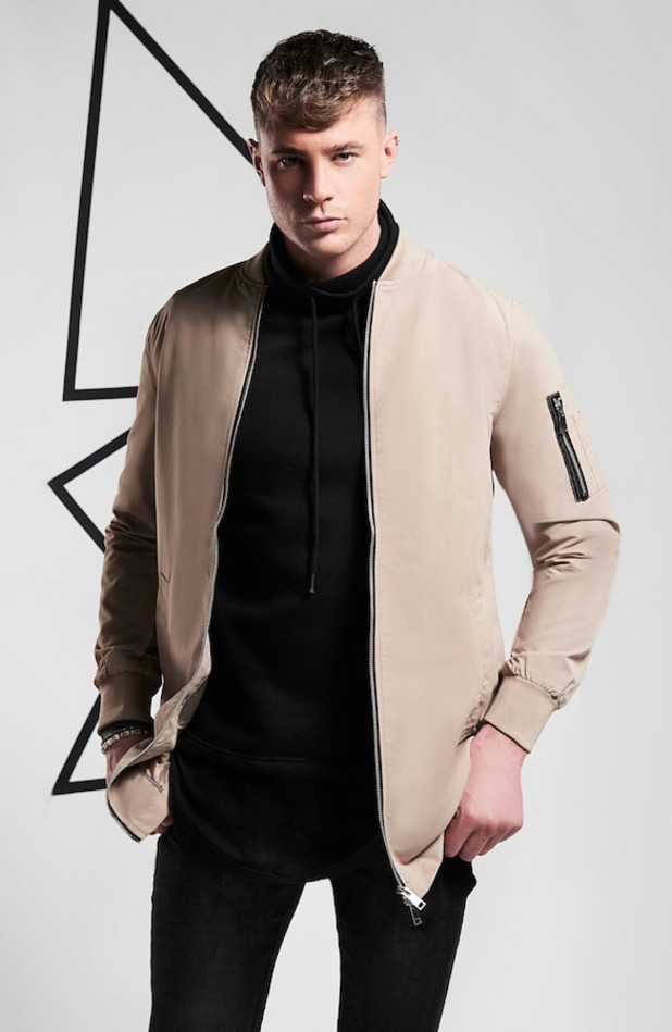 Geordie Shore's Scotty T is announced as the new face of BoohooMAN, wearing camel bomber 31st March 2016