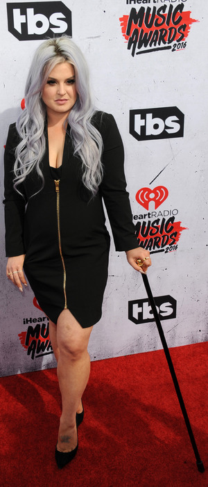 Kelly Osbourne uses walking stick at the iHeartRadio Awards at The Forum in Los Angeles, 3rd April 2016