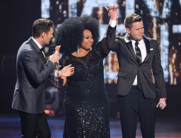 Judge Ryan Seacrest announces American Idol Season 15 winner Trent Harmon with runner-up La'Porsha Renae, onstage at FOX's American Idol Season 15 Finale on April 7, 2016.
