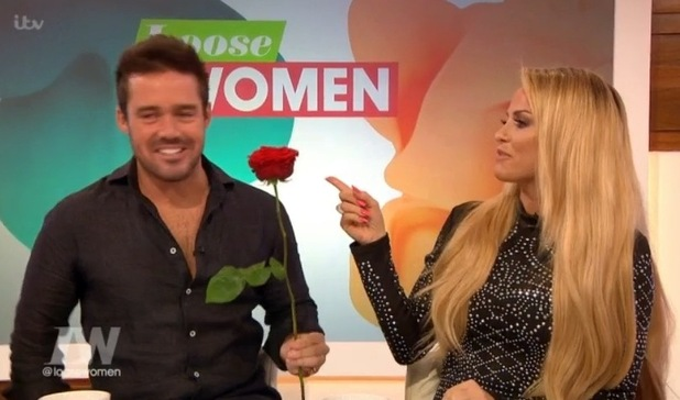 Spencer Matthews gives Katie Price a rose on Loose Women. 12 April 2016.