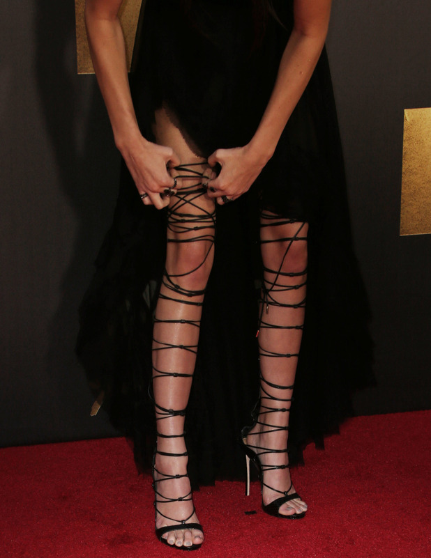 Kendall Jenner tries to avoid wardrobe malfunction during MTV Movie Awards, Los Angeles, 9th April 2016