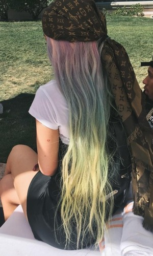 Kylie Jenner switches up peach hair to rainbow braids at Coachella ...