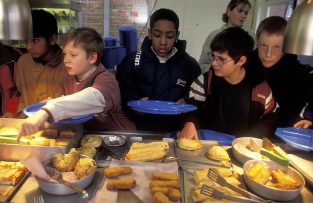 Children queueing for school dinner in Chippenham, 32st March 2010