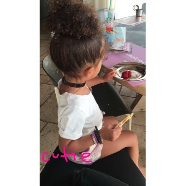 North West wears her hair in a curly bun, 29th April 2016