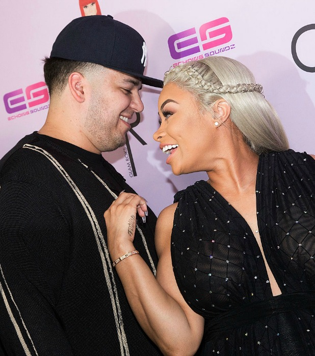 Blac Chyna (L) and Rob Kardashian arrive for her Blac Chyna's birthday celebration and unveiling of her 'Chymoji' Emoji Collection at Hard Rock Cafe, Hollywood, CA on May 10, 2016 in Hollywood, California.