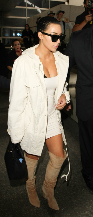 Keeping Up With The Kardashians star Kim Kardashian wears mini dress and boots at L.A.X Airport after partying in Cannes, 18th May 2016