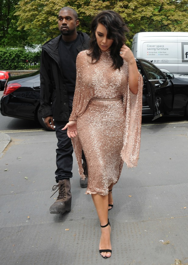 Kim Kardashian and her husband Kanye West leave their hotel and head to The Vogue 100 Festival, where Kim is giving a speech 21 May 2016