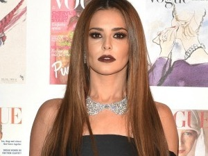 Cheryl vamps it up in thigh high leather boots at Vogue Centenary Dinner