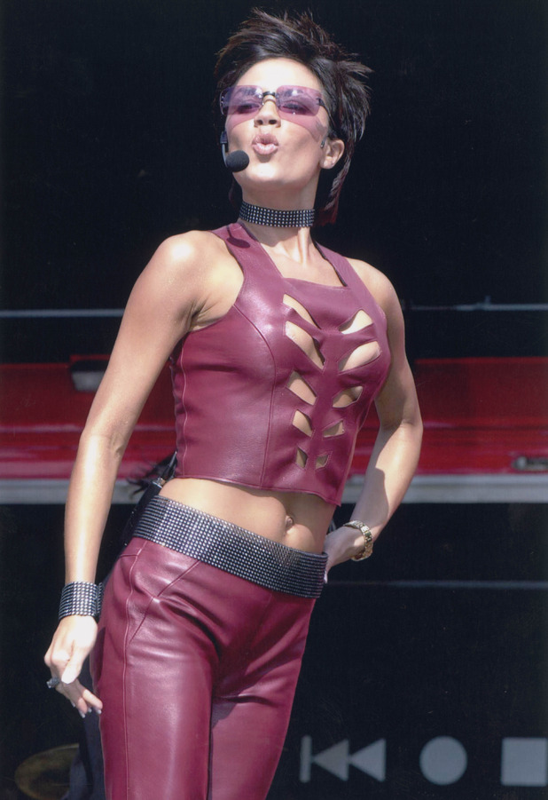 Victoria Beckham performing on stage in burgundy leather, London, 6th August 2000
