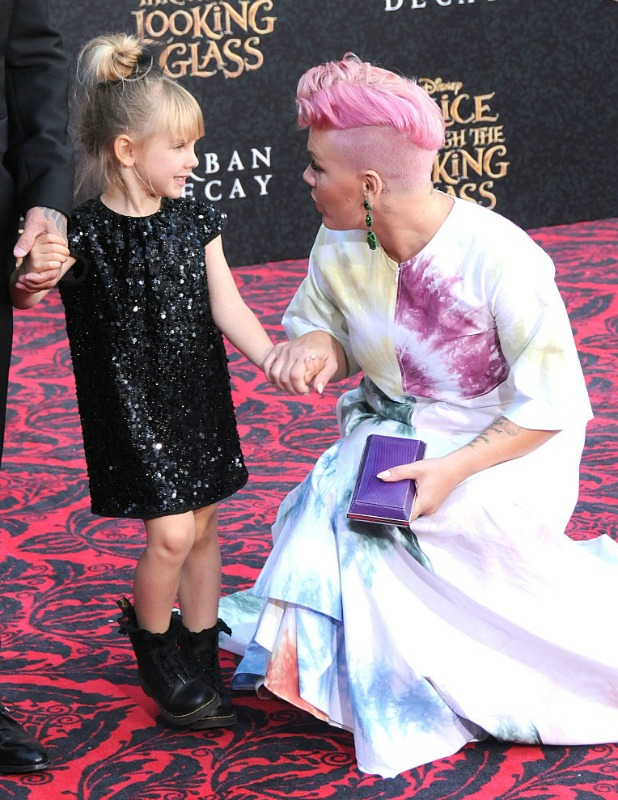 Motorcycle Racer Carey Hart, daughter Willow Sage Hart and Recording Artist Pink, aka Alecia Moore attend the premiere of Disney's 'Alice Through The Looking Glass' at the El Capitan Theatre on May 23, 2016 in Hollywood, California.