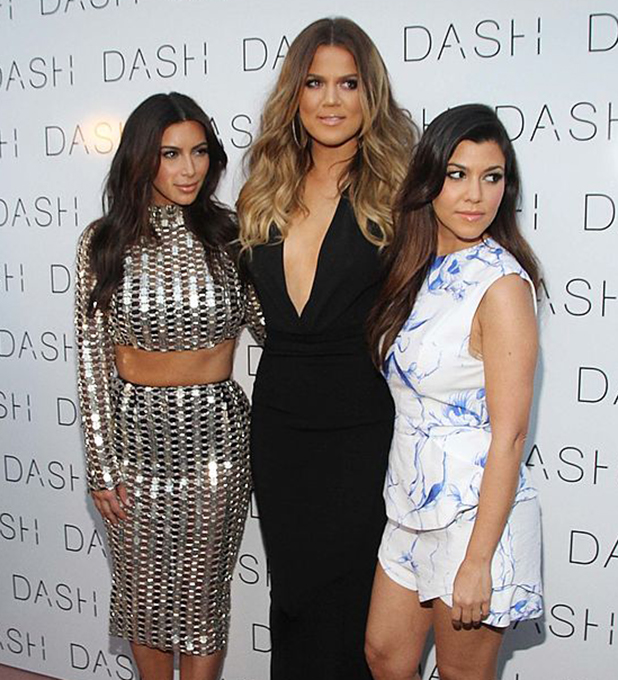 Kim Kardashian, Khloe Kardashian and Kourtney Kardashian attends the grand opening of DASH Miami Beach at Dash Miami Beach on March 12, 2014 in Miami Beach, Florida.