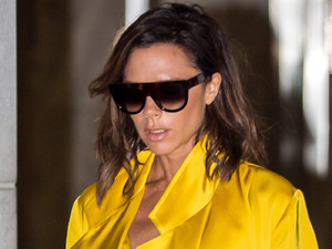 Victoria Beckham makes an uncharacteristic outfit choice and stuns in acid yellow