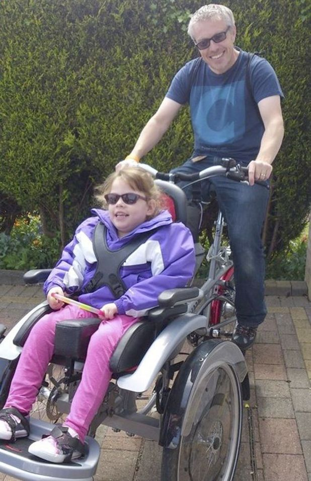 Effie and her dad like to go out cycling together