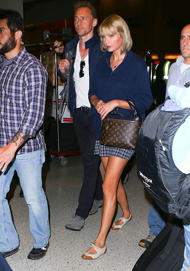 Taylor Swift and Tom Hiddleston are seen at LAX on July 06, 2016 in Los Angeles, California.
