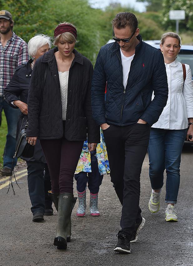 Taylor Swift and new boyfriend Tom Hiddleston enjoy a romantic walk on the beach near Lowestoft in Suffolk July 2016