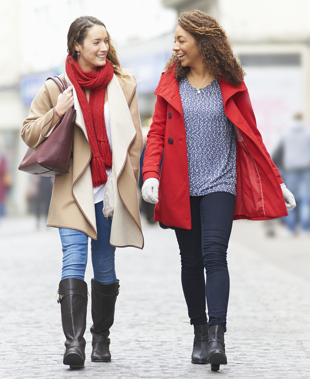 Two women walking down the street and talking