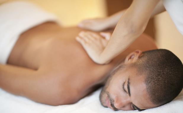 Woman erotically massaging a man
