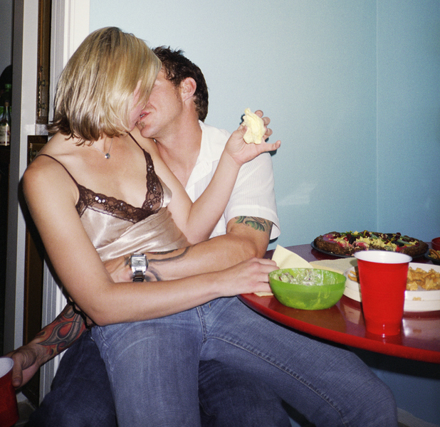 Drunk couple making out at a party
