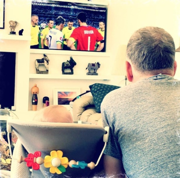 Patrick Kiely watching the football with his son