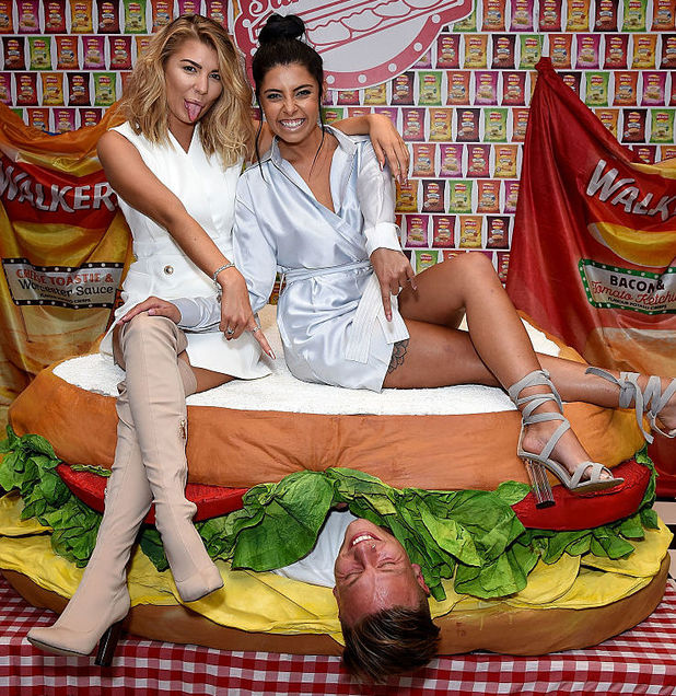 Olivia Buckland (L), Alex Bowen (in sandwich) and Cara De La Hoyde attend as Walkers launch the first ever Crisp Sarnie Club to celebrate the launch of their sandwich flavoured crisps on September 6, 2016 in London, England.
