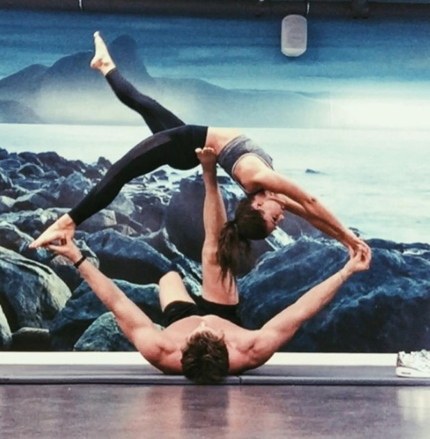 Louise Thompson does yoga moves with boyfriend Ryan